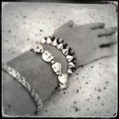 Bracelets on arm — Stock Photo