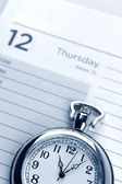 Watch on diary — Stock Photo