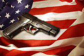 Gun on flag — Stock Photo