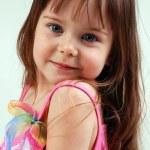 Pretty little girl in pink dress — Stock Photo #4148457