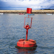 Red buoy in the sea - Stock Photo