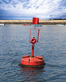 Red buoy in the sea — ストック写真