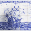 Ancient portuguese tiles with a ship - Stock Photo