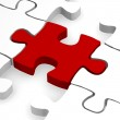 Red piece of puzzle — Stock Photo #25290965