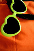Green sunglasses — Photo