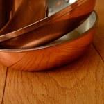 Three luxury copper pan — Stock Photo #29414871