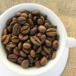 Cup full of coffee beans — Stock Photo