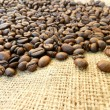 Burlap and coffee beans — Stock Photo