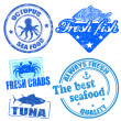 Set of sea food grunge rubber stamps - Stock Vector