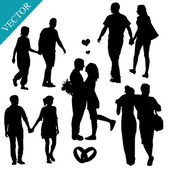 Romantic couples silhouettes — Stock Vector