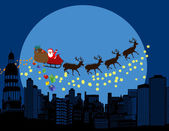 Santa claus and deers silhouettes flying over a city — Stock Vector