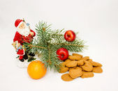 Christmas composition of cookies, Santa, fir, tangerine on white — Stock Photo