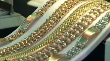 Golden bracelets — Stock Video #12772242