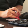 Business woman using a calculator — Stock Video