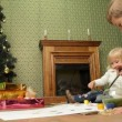 Stock Video: Children paint on canvas. Two small children sitting on floor and paint Christmas tree.