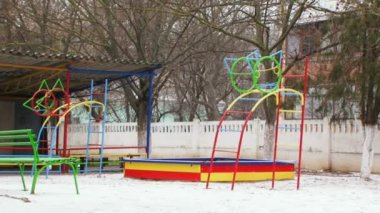 Playground during winter snowstorm. — Stock Video