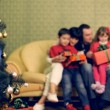Stock Video: Couple celebrating Christmas with their children. Celebrating with family.