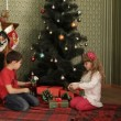 Children Under A Christmas Tree — Stock Video #14960609