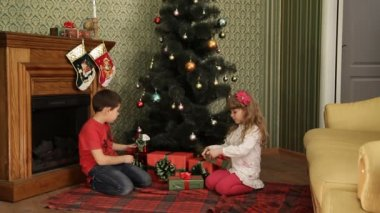 Children Under A Christmas Tree — Stock Video