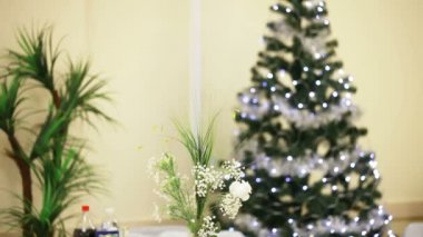 Sparkling Christmas tree and other holiday decorations. — Stock Video