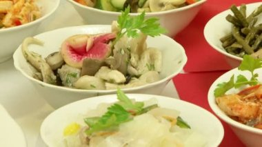 Different salads and other food on a festive table. — Stock Video