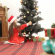 Stock Video: Girl preparing for Christmastime.