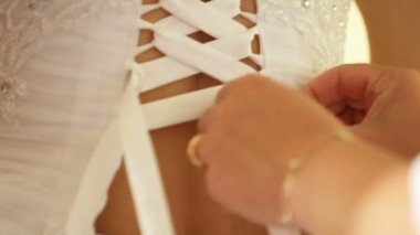 Lacing up a corset of a wedding dress. — Stock Video