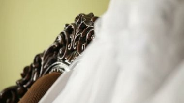 Bridal veil and dress prepared for the ceremony. — Stock Video