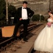 Newlyweds standing on the rail — Vidéo