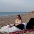 Newlyweds relax on the sandy beach. — Stok video