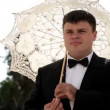 Groom under umbrella — Vídeo de stock