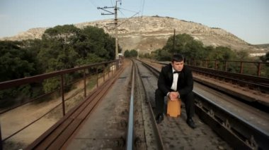Groom nervously waiting by the rail — Stock Video