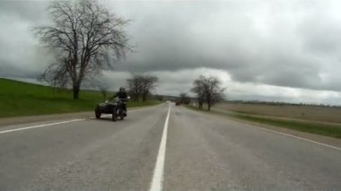 Sidecar motorcycle moving down the road. — Stock Video