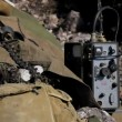 Stock Video: Military transmitter. Military transmitter is close to a military ammunition. Motion zoom.