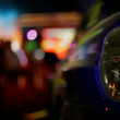 Nightlife. Rear lights car closeup. In the background a disco. The background is blurred. Moving camera.  — Stock Video