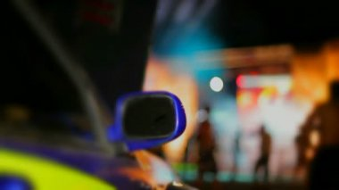 Sports car. Rear-view mirror on a beautiful sports car. The background is blurred. — Stock Video
