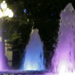 Some beautiful fountains. One large and six small fountains, each working with its backlight. — Stock Video