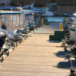 Parade of excursion boats. Pier with lots of moored boats. — Stock Video