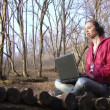 Womfinishes work with laptop. Womfinishes work with laptop on background of beautiful forest. — Stock Video #18883891