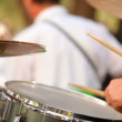 Stock Video: Musiciplays drums. Professional drummer plays drums in orchestra. foreground is blurred.