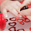 Woman paints the nails. A woman getting ready for valentines day. — Stock Video
