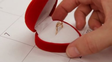 Surprise for Valentines Day. A man puts a wedding ring on Valentines Day. Close-up. — Stok video