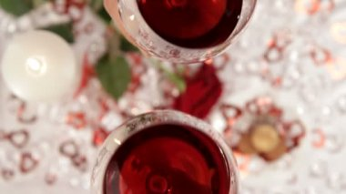 Date for the holiday. Two wine glasses filled with red wine. — ストックビデオ
