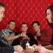 Dinner. Young couple celebrate valentines day for a romantic dinner. Three boys watching them and eating popcorn — Stock Video