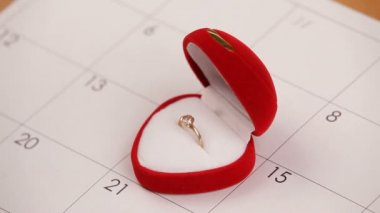 Surprise for Valentines Day. A man puts a wedding ring on Valentine's Day. Close-up. — Video Stock