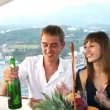 Stock Video: Beautiful couple sitting on deck of yacht drinking champagne