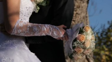 Bride and groom holding a wedding bouquet — Stock Video