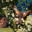 Stock Video: Couple Among Flowers
