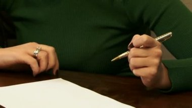 Woman signing and stamping a document — Stock Video