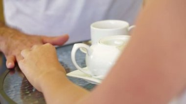 Romantic meeting in a cafe. Close-up. In a cafe. — Vídeo de stock